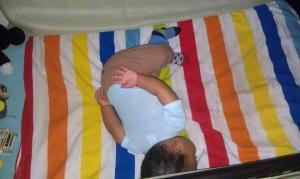 My son, almost a year old, resting peacefully in his crib